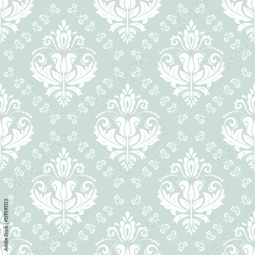 Damask classic light blue and white pattern. Seamless abstract background with repeating elements. Orient background - 159545123