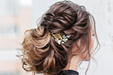 attractive young brunette woman with beautiful hairstyle with hair detail accessory, closeup rear view - 159552718
