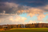 Autumn field landscape with beautiful sunset sky