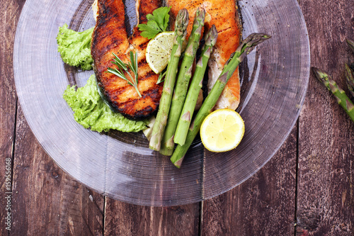 Grilled salmon and asparagus on plate - 159556168