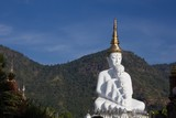 White buddha statue in Thai temple