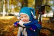 little boy with bike in autumn park