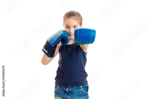 Póster little young girl practicing a boxing
