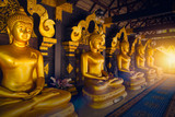 Golden Buddha row in Thailand temple at Lampang province.