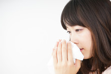 Young Woman Blowing Her Nose Sticker