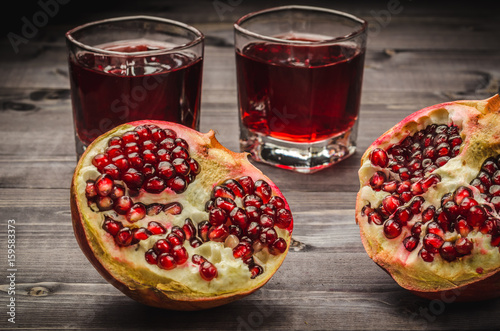 two pomegranates and juice/two pomegranates and juice in a glass Poster