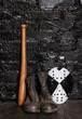 Boots, hockey mask and baseball bat
