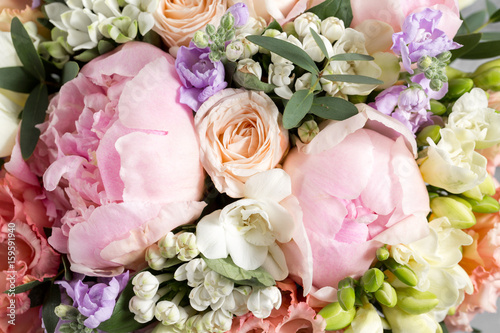 luxurious and elegant bouquet of roses and Other flowers. Composition colors on gray background. Copy space.