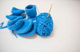Closeup blue knitting on White background .