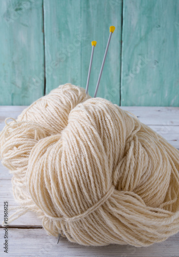 knitting yarn hanks on wooden surface Poster