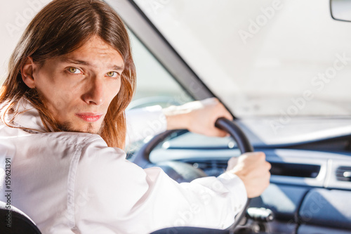 Man in car looking at back seat