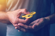 Quadro Yellow fidget spinner in male hand
