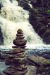 Stone pyramid near a tropical waterfall. - 159646102