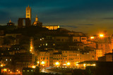 Night view of the historical center of Siena with the Duomo cathedral. Tuscany. Italy.
