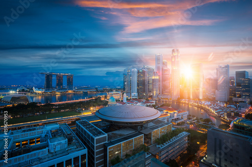Obraz na plátne Singapore city with sunrise by day to night photo