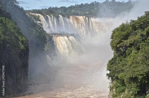 The Iguazu Falls, Iguazú Falls, Iguassu Falls, or Iguaçu Falls, on the Iguazu River on the border of the Argentine province of Misiones and the Brazilian state of Paraná.  - 159671948