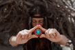 boho woman holding cone necklace in hands. Soft focus