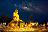 THE NIGHT WITH MILKY WAY, BUDDHA STATUES AND CANDLELIGHT PROCESSION: On a religious observance day, after sunset, Buddhists and worshipers will gather around pagoda to start candlelight processions.