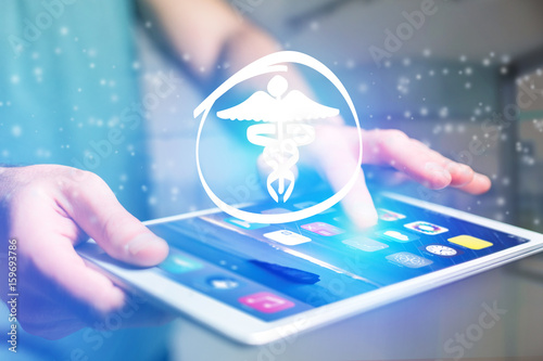 Pharmacy icon going out a tablet interface - technology concept