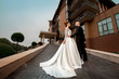 glamour young just married couple in wedding suits