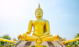 Golden Buddha statue of Big Buddha over blue sky