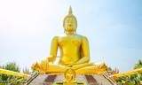 Golden Buddha statue of Big Buddha over blue sky