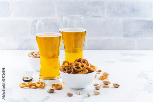 Beer and snacks on white background Poster