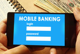 Hands holding phone with page mobile banking. Online payment concept.