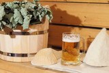 A mug of light beer and bath accessories are in the interior of the Russian bath. - 159732109