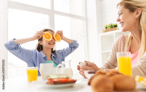 happy family having breakfast at home kitchen - 159755513