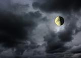 Moon glowing in the dark night sky