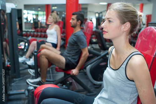 young sporty woman in the gym centre