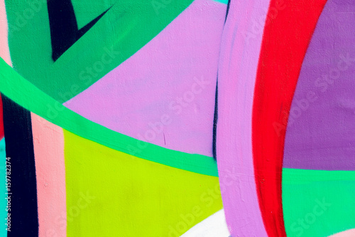 Bright wall with detail of a graffiti, street art. Abstract creative drawing fashion colors. Modern iconic urban culture street of youth, stylish picture for backdrop