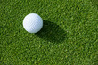 Top view of golf ball on a putting green