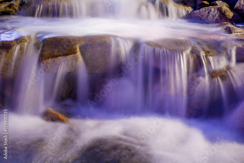 Waterfall with light in the night - 159800135