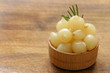 marinated pearl onions in a wooden bowl