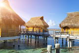 houses over the transparent quiet sea water. Tahiti - 159820323