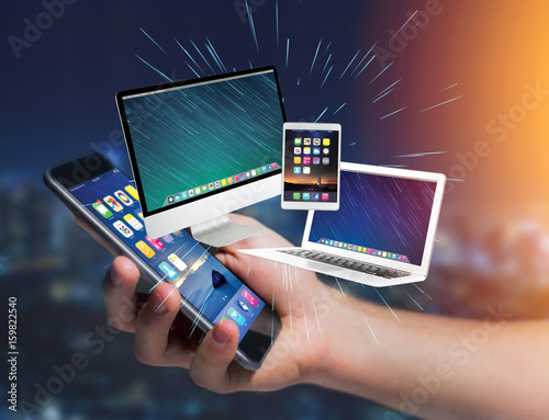Computer and devices displayed on a futuristic interface with business network - Multimedia and technology concept