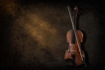 Instrument for violin and orchestra on a dark background. Place for inscription