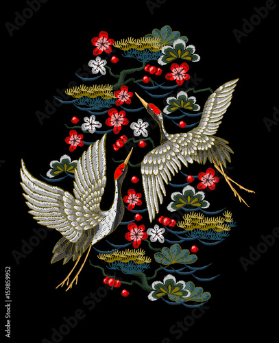 Japanese white cranes with red flowers. Embroidery vector.