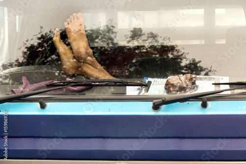 Male feet on the dashboard of the truck Poster