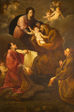 TURIN, ITALY - MARCH 13, 2017: The painting of Madonna with the St. Francis of Asissi and St. Lorenzo in church Chiesa di Santa Maria in Monte by Giuseppe Buccinelli (19. cent.) - 159870951