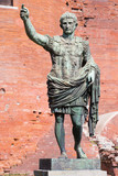 Turin - The bronze statue of emperor Octavianus Augustus in front of The Palatine Gate as the copy of marble stutue in Vaticans Museum in Rome from 1. cent.