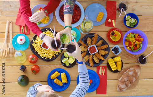 Top view of group of people having dinner together while sitting - 159887728
