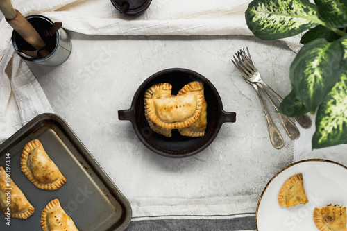 Homemade Empanadas in Rustic Dish on Table - 159897334