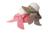 Woven hat with pink, beige and brown,beige, decorated with a pink bow tie, isolated on white background.