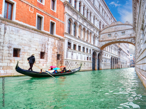 Traditional Gondola and the famous Bridge of Sighs in Venice