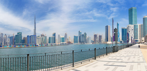 DUBAI, UAE - MARCH 29, 2017: The skyline over the new Canal and Downtown and the promenade.