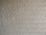 The inscription in the ancient language. The walls of the temple. Cambodia