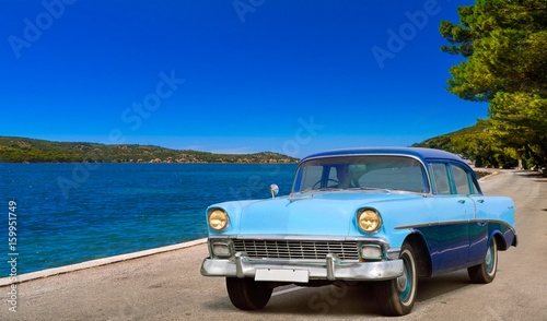 foto auf acrylglas classic taxi parked near the beach in vinales cuba nikkel. Black Bedroom Furniture Sets. Home Design Ideas